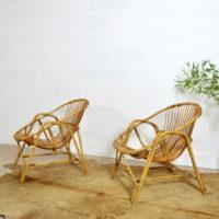 Paire de fauteuils coquille en rotin vintage