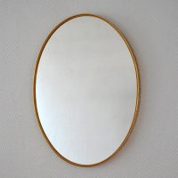 Grand miroir ovale laiton années 50